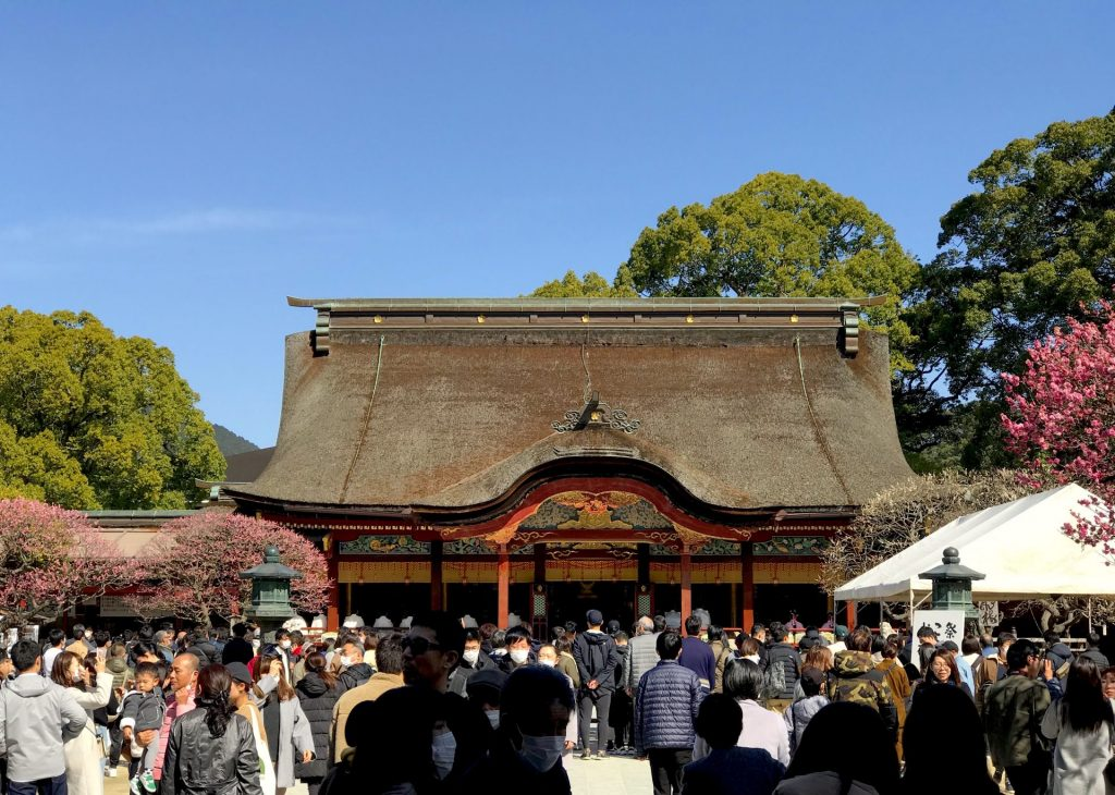 This is the Dazaifu Tanmangu Shrine in Fukuoka. A lot of people can be seen in the photo each praying for ther heart's desires.