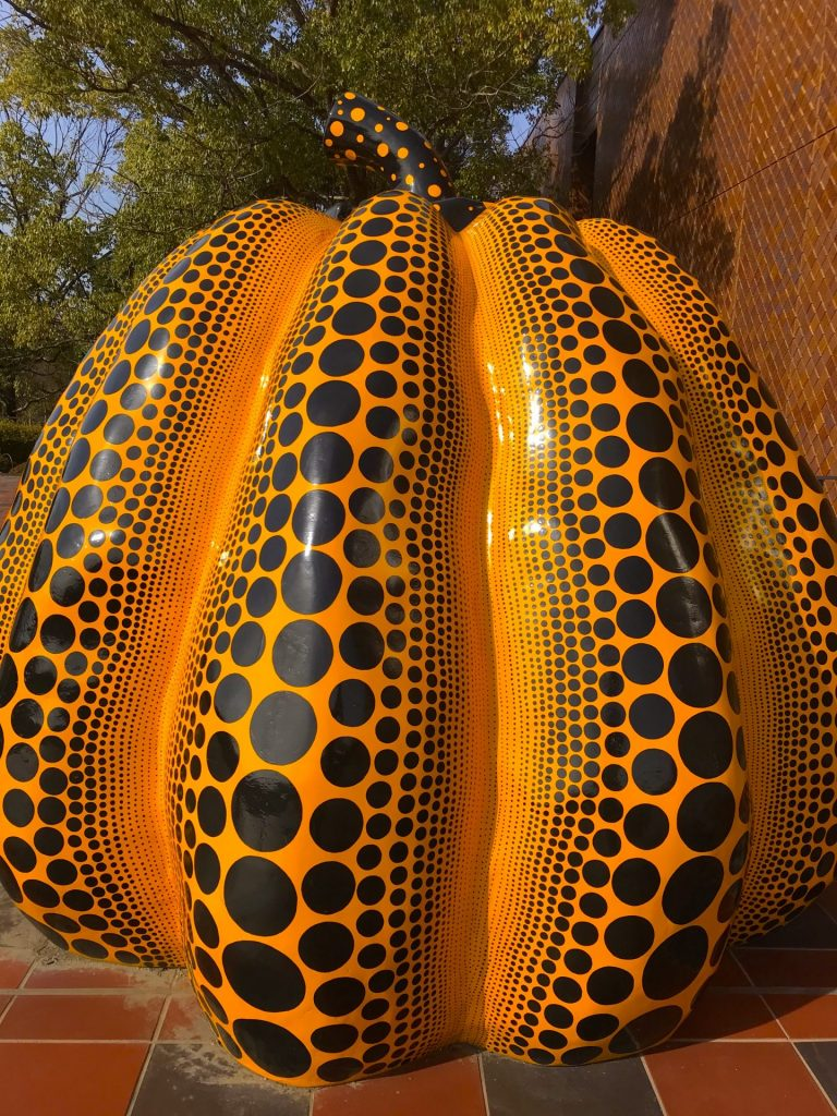 This artwork is by the famous Japanese artist, Yayoi Kusama. This one's a giant pumpkin with distinctive dots on it, the artist's signature. You'll chance upon this outside the Fukuoka Art Museum.